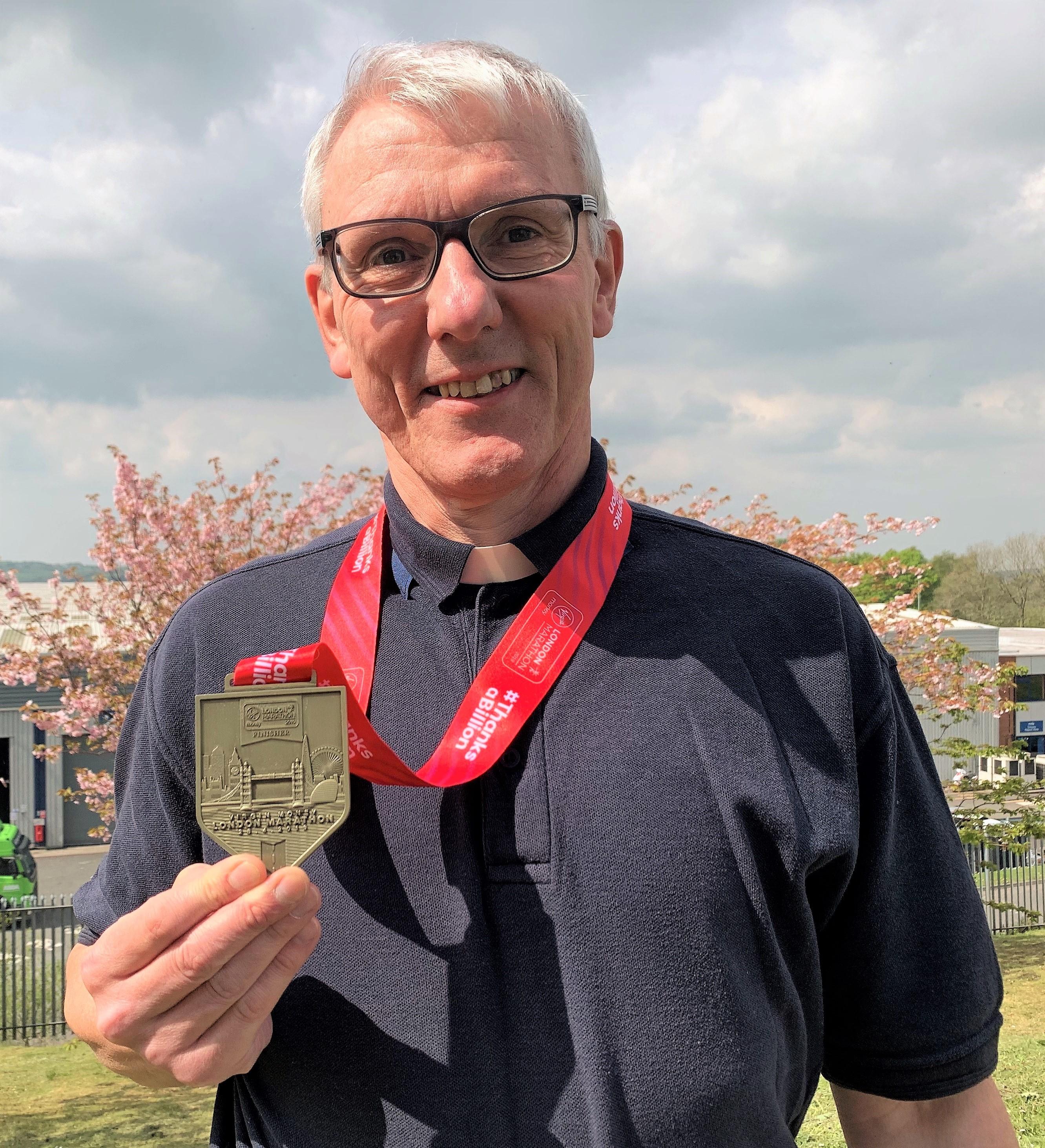 Marathon runner, Rev Ian Enticott, achieves his dream and raises